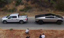 Who will win?!: Cybertruck Tesla and Ford F-150 competing in the tug of war