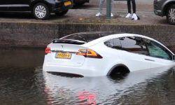Tesla dipped their electric cars in a puddle for security check