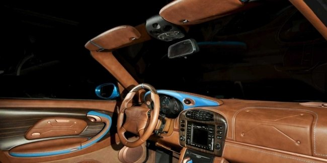 The interior of the Porsche 911 convertible is generously decorated tree