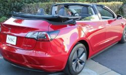 Tesla Model 3 in the back of a convertible