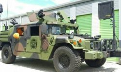 The gun as a gift: for sale military Humvee