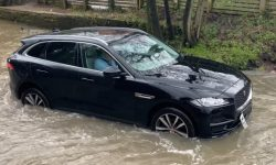 Jaguar F-Pace fails to cope with puddle (video)