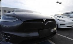 Tesla starts returning money to customers