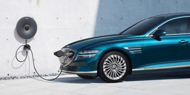 When will the first Genesis electric crossover debut?