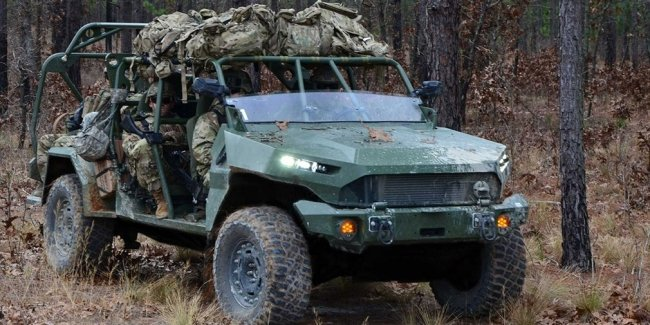 GM unveils electric car for U.S. Army